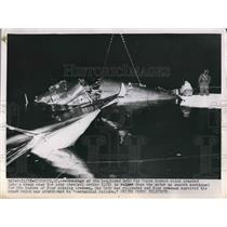 1952 Press Photo B-50 bomber crashes near Army base. Crew bodies still missing.