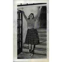 1939 Press Photo Gertrude Plumer Stretches Height for Aeronautics Exam