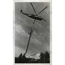 1967 Press Photo Jim Lematta placing a mile-long chairlift at Mt. Meadows Resort