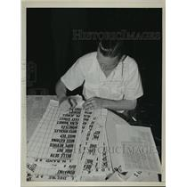 1939 Press Photo A man making charts for horse race betting - net33322