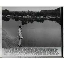 1956 Press Photo Arthur Williams bids 1,300,000 for swamp & island in Maryland