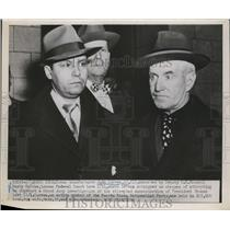 Press Photo John Correa escorted by Harry McCabe leave federal court