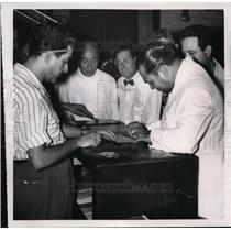1951 Press Photo Fulgencio Batista Signing Voting Card in Eleciton Office, Cuba