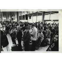 1984 Press Photo Portland International Airport travelers contribute to economy