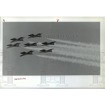 1990 Press Photo Seven planes of the Canadian Snowbirds fly over Fairchild AFB.