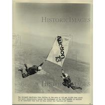 1976 Press Photo Skydivers with Auction 13 banner for channel 13 - lfx02438
