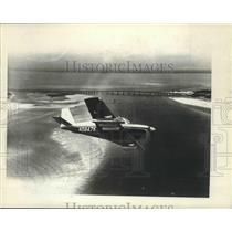 Press Photo Small Airplane Flies Near Beach - nox02616