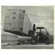 1965 Press Photo Planes - William Paulus Hoists Crated Aircraft for Shipment