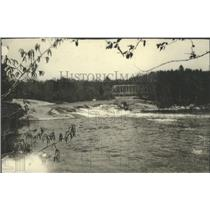 1927 Press Photo A Scenic View of the River and Bridge at Keshena, Wisconsin