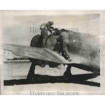 1939 Press Photo Italian Pilot Climbs Into an Italian Plane Ready to Take Off