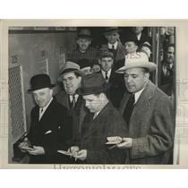 1940 Press Photo John J. Dunnigan buys first mutual ticket at Jamica - nef60137