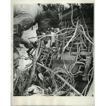 1963 Press Photo Student Investigators examine remains of a crashed airplaine