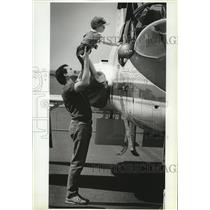 1987 Press Photo Dave Goicoechea & son John Check out NASA T38 trainer aircraft.