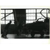 1992 Press Photo Personnel moves a jet at Fairchild for a press conference