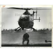 1994 Press Photo Man ducks as medical helicopter takes off at Fairchild