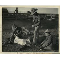 1937 Press Photo Cowboys Hold Down and Brand a Calf - mjx24515