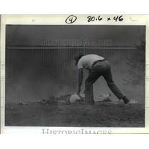 1982 Press Photo Stunt man, Siros on the ground after stunt - orb53025