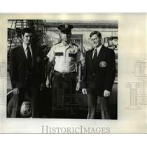 1973 Press Photo Police officer Dave Harpool & Ken Wright model civilian uniform
