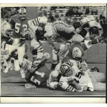 1974 Press Photo Jess Phillips New Orleans Saints Diving Over Line of Scrimmage