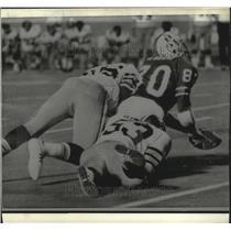 1974 Press Photo Rick Kingrea Linebacker New Orleans Saints Tackles Bob Adams