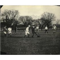 1925 Press Photo Men playing soccer on a field - net31162