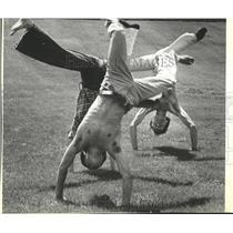 1981 Press Photo Portland State University students practice cartwheel stunt