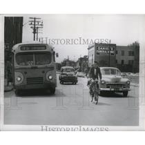 1955 Press Photo James Hanna of Ohio Riding Bicycle in Traffic - nef53833