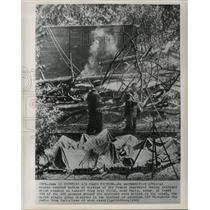 1962 Press Photo An official counts covered bodies of Air France jetliner crash
