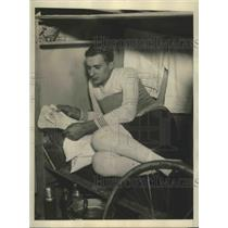 1928 Press Photo Armand Blanchonett Reading Fan Mail While Partner Keeps Lead