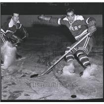 1956 Press Photo Carl Cirullo Slides Towards the Puck During Hockey Game