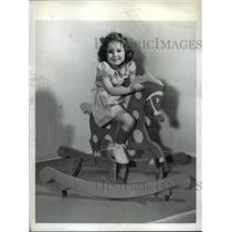 1942 Press Photo New York Rita Gruberger tests rocking horse with wheels NYC