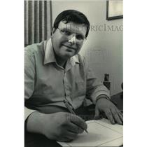 1987 Press Photo Father Dennis Budka Drawing Cartoons for the Catholic Herald