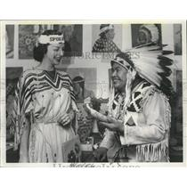 1956 Press Photo Ignace Camille shows Miss Spokane an Indian hide scraper