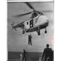 1958 Press Photo British Defense Minister Duncan Sandys lowered by a helicopter