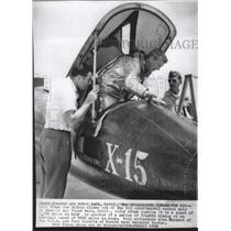 1961 Press Photo NASA Test Pilot Joe Walker climbing out of X15 plane at Edwards