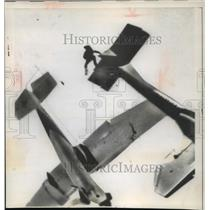 1962 Press Photo Pilot jumping from plane after collision with another plane.
