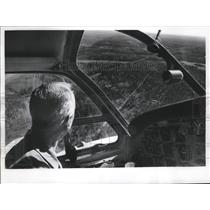 1964 Press Photo Kenneth A. Cook on Civil Air Patrol mission has a great view