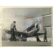 1936 Press Photo Mechanics putting final touched on the Crosby Racing Plane