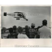 1969 Press Photo Curtis Pusher, 60, flies plane at Oshkosh during ceremony.