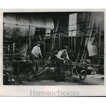 1953 Press Photo Edward Bryant and Otto Walters Working On Curtiss Type Machine