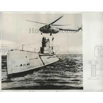1961 Press Photo Russian Submarine with Russian Helicopter Hovering Over it