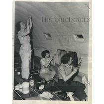 1945 Press Photo Girls from fabric shop reline interior of PAA's Stratoclipper