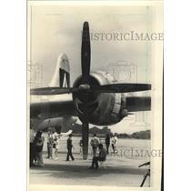 1985 Press Photo Visitors Under Engine of B-29 Superfortress in Parkersburg