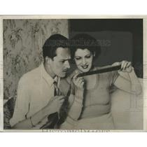 1933 Press Photo Prince of Asturias, fiancee look over a photographic film