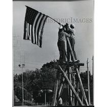 1968 Press Photo Sea Scouts raise a flag at the weekend Scout Exposition.