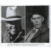 1975 Press Photo James Coburn demonstrates his acting versatility in two roles