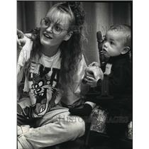 1993 Press Photo mother with her 7-month-old during a reading of a child's book