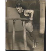 1928 Press Photo Kid Sullivan Junior lightweight swinging on the bars