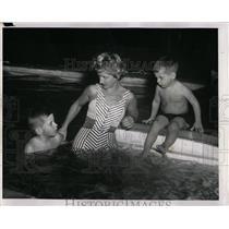 1961 Press Photo Mrs.G.Watson & her sons swimming. - RRW92393