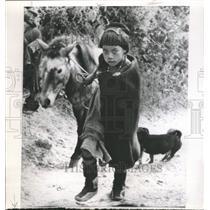 1962 Press Photo Monpa Youngster Climbs A Hill - RRW44155